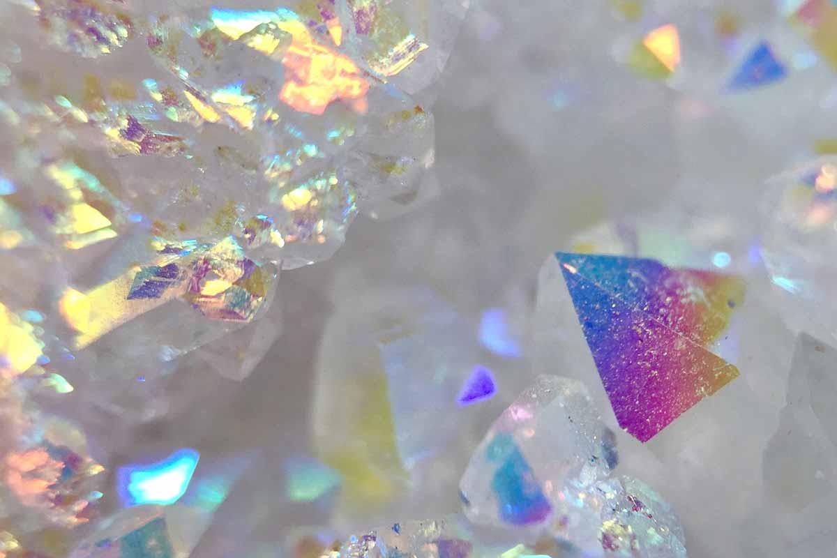 Meditating-with-Rainbow-Aura-Quartz-and-its-Healing-Properties
